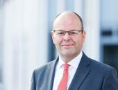 Portrait von Klaus Hendrik Potthoff. Er ist stellvertretender Leiter des Geschäftsbereichs Rehabilitation und Entschädigung bei der Kommunalen Unfallversicherung Bayern.