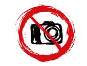 Illustration eines Verbotsschildes, in dem eine Kamera abgebildet ist.